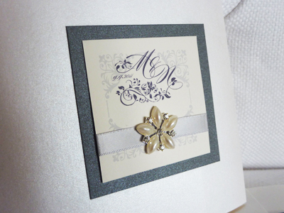 Invitation 916: Antique Pearl, Charcoal Pearl, Cream Smooth, Burgues Script, Phyllis, Silver Ribbon, Brooch/Buckle B
