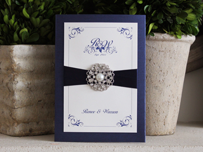 Invitation 920: Navy Pearl, Cream Smooth, Cotillion, Monotype Corsiva, Navy Ribbon, Brooch/Buckle A6