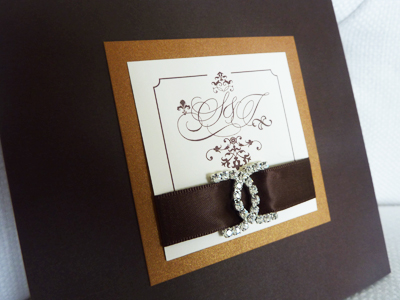 Invitation 930: Chocolate Linen, Cognac, Cream Smooth, Yves Script, Phyllis, Brown Ribbon, Brooch/Buckle E