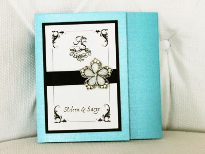 Invitation 931: Turquoise Pearl, Black Linen, White Smooth, Ex Ponto, Myriad Pro Light, Black Ribbon, Brooch/Buckle A7