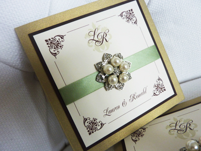 Invitation 939: Gold Pearl, Chocolate Smooth, Cream Smooth, Renaissance, Copperplate, Light Sage Ribbon, Brooch/Buckle T