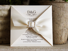 Invitation 702: White Gold, Cream Smooth, Origins, High Tower, Antique Ribbon, Brooch/Buckle O