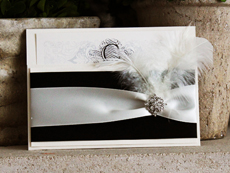 Invitation 716: White Gold, White Gold, Cream Smooth, GE LaraScript, High Tower, Black Ribbon, Black Ribbon, Antique Ribbon, Brooch/Buckle A8, Feather Color White