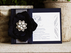 Invitation 724: Navy Pearl, Cream Smooth, Origins, High Tower, Black Ribbon, Charcoal Ribbon, Brooch/Buckle T