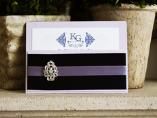 Invitation 728: Orchid Pearl, Orchid Pearl, Cream Smooth, Beau Rivage, High Tower, Navy Ribbon, Lilac Ribbon, Brooch/Buckle A17