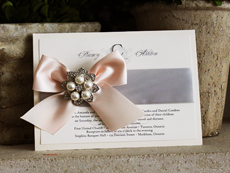 Invitation 738: Ivory Pearl, Cream Smooth, Yesterday, High Tower, Silver Ribbon, Blush Ribbon, Brooch/Buckle T