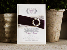 Invitation 744: White Gold, Cream Smooth, Beau Rivage, High Tower, Silver Ribbon, Grape Ribbon, Cream Lace, Brooch/Buckle W