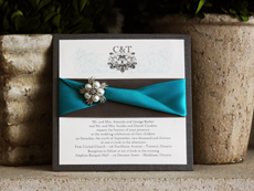 Invitation 747: Charcoal Pearl, Cream Smooth, High Tower, Charcoal Ribbon, Peacock Ribbon, Brooch/Buckle A21
