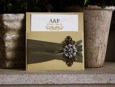 Invitation 785: Gold Dust, Gold Dust, Cream Smooth, Beau Rivage, High Tower, Light Sage Ribbon, Light Sage Ribbon, Brooch/Buckle A19, Metal Filigree F4 - Bronze